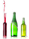 Lots bottles  with splashes Royalty Free Stock Photo
