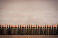 Lots of bullets on a wooden background Royalty Free Stock Photo