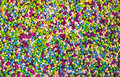 Lots of colorful fusible plastic beads used for arts and craft.