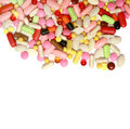 Lots of colorful tablets drug  and pills, medical background. Macro. Royalty Free Stock Photo