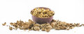 Lots of cracked open walnuts in a cup on a white background Royalty Free Stock Photo