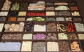 Lots of different spices a closeup image kinds there are arranged in a large wooden box Royalty Free Stock Photography