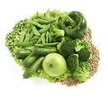 Lots of diffrent green foods arranged together isolated on a whi fresh white background with clipping path Stock Photo
