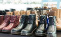 Lots of leather wintry male shoes at fashionable shop Stock Photos