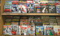 Lots of magazines on shelves popular store Royalty Free Stock Photo