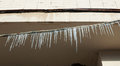 Lots of melting icicles hanging from the frozen wires Royalty Free Stock Photos