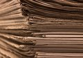 Lots of newspapers full frame background with stacked brown toned Royalty Free Stock Photo