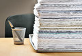 Lots of paperwork ahead a huge pile on a desk Royalty Free Stock Photos