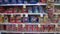 Lots of pet food on shelves tom thumb store Stock Photos