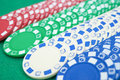 Lots of poker chips on casino table Royalty Free Stock Image