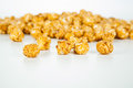 Lots of popcorn balls with sugar on a white background Stock Image