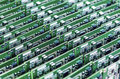 Lots of printed circuit boards with mounted and soldered componentry arranged in rows together horizontal image Royalty Free Stock Images