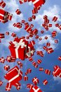Lots of red gift boxes flying in the air Royalty Free Stock Photos