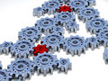 Lots of silver gears with two red Royalty Free Stock Photo