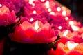 Lotus candle light illuminate a dark surrounding Stock Photos