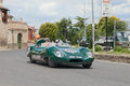 Lotus eleven climax le mans in mille miglia the crew a cavalli p pezzotti on a rare vintage racing car travel tuscan village Royalty Free Stock Photos