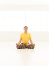 Lotus position studio man young doing yoga in white window Stock Photo