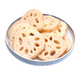 Lotus root slices in plate on white Royalty Free Stock Photo