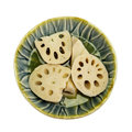 Lotus root small bowl with slices of isolated on white Royalty Free Stock Image