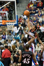 Lou williams attempts a dunk of the philadelphia ers to the ball during game against the detroit pistons at the the palace of Royalty Free Stock Photo