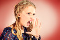 Loud shout portrait of a furious shouting blonde girl posing at studio retro style Stock Image