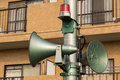 Loudspeakers green and red light on a tall column Stock Images