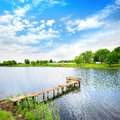Lough wooden dock pier on a lake in summer sunny day Stock Image