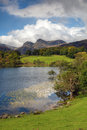 Loughrigg tarn cumbria beautiful in late summer england Stock Photos