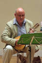 Louis de bernieres playing his mandolin author of captain corelli s a Stock Photos