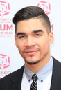 Louis smith mums arrives for the tesco mum opt the year at the savoy london picture by henry harris featureflash Stock Photos