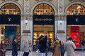 Louis vuitton shop in milan people passing by galleria vittorio emanuele italy Stock Photography
