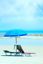Lounge chair at beach empty by the Royalty Free Stock Image