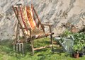 Lounge chair in a country side garden countryside with tools Stock Images