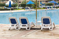 Lounge chairs pool Royalty Free Stock Photo