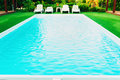 Lounge chairs and pool Royalty Free Stock Photo