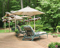 Lounge chairs under patio umbrella Royalty Free Stock Photo