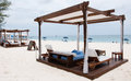Lounger bed cabana on the white sand beach Stock Photo