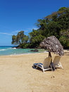 Lounger with parasol on a tropical beach thatched beautiful Stock Photos