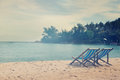 Loungers on the beach with a retro image toning two Royalty Free Stock Photos