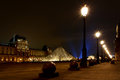 Louvre Museum and its pyramid Royalty Free Stock Photo