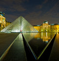 Louvre museum at night paris france europe Royalty Free Stock Photo