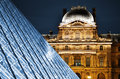 Louvre museum in paris france by night Stock Image