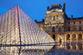 Louvre museum and pyramid, night in Paris