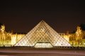 Louvre by night the famous le lit up in paris france Stock Photography