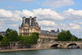 The Louvre Palace Buildings & Seine River, Paris France. Royalty Free Stock Photo