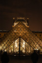 Louvre paris by night museum pyramid in at a full moon beautiful lighted on holiday france Royalty Free Stock Image