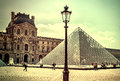 The Louvre in Paris on a sunny day. Vintage view. Louvre in Paris old retro style.
