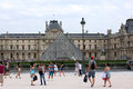 Louvre paris tourists in front of the most visited museum in the world in france view from the square in front of the glass Royalty Free Stock Photography