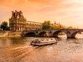 Louvre and seine palais du by the in beautiful orange sun gleam paris france Stock Image