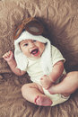 Lovable baby portrait of a months in funny pilot hat toned image Stock Image